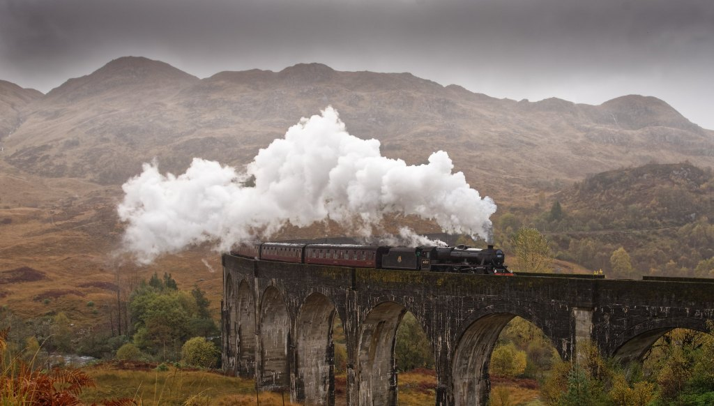 Jacobite Railway, aka the Harry Potter train, traveling with a lot of steam over the famous tracks.