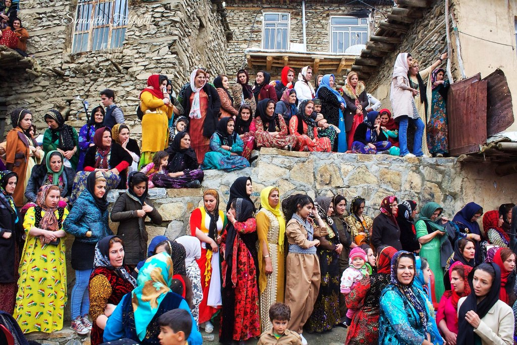 People in traditional clothing to celebrate Nowruz in Iran in Spring.