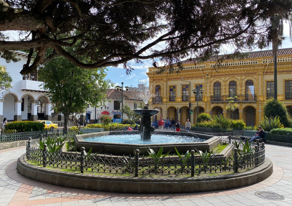 Beautiful Parque Calderon in Cuenca, Ecuador - sitting here and people watching is one of the best things to do in Cuenca.