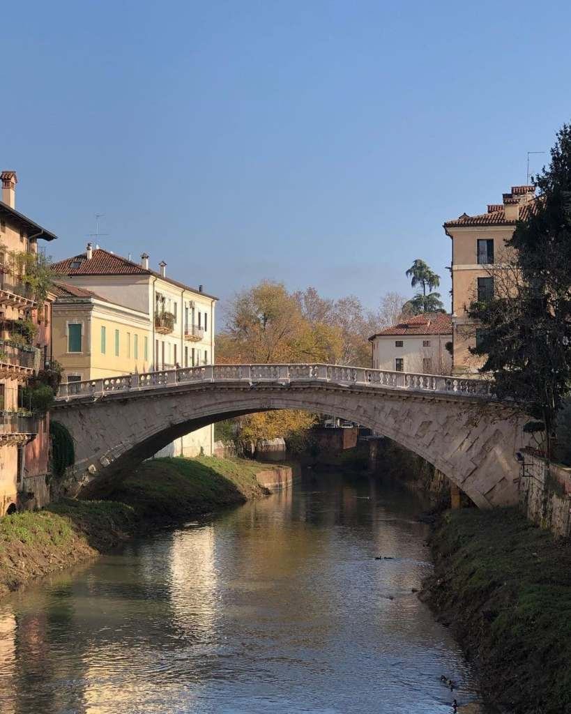 San Michele Bridge in Vicenza with water reflections.