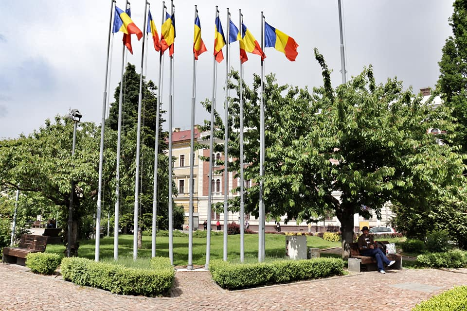 A row of Romanian flags in Avram Iancu Square in Cluj-Napoca, Romania