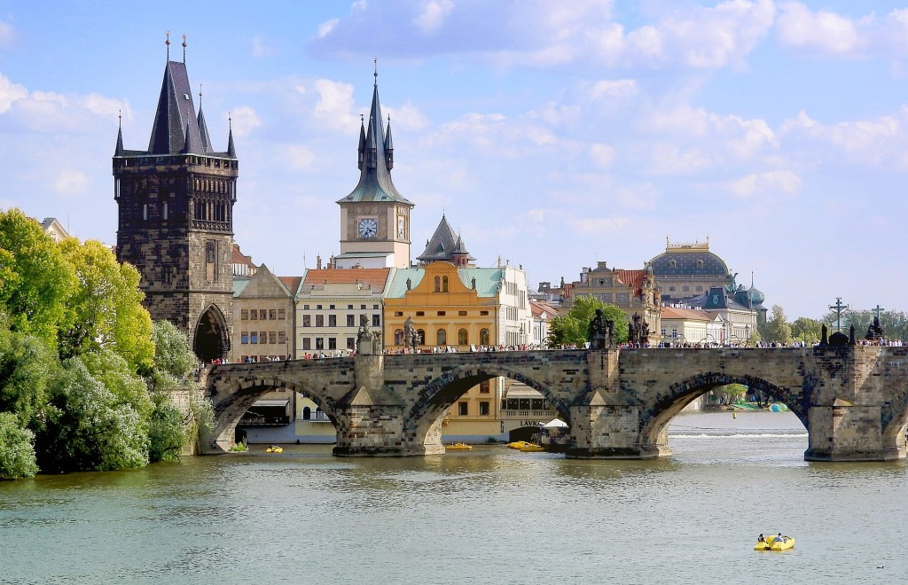 Charles Bridge in Prague with gorgeous architecture in the background.