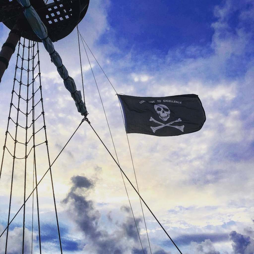 Pirate flag flying on Calico Jack's, a floating bar in Bermuda