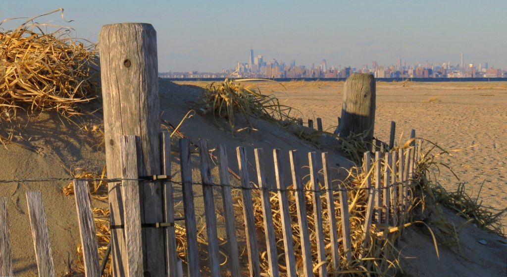 Sand Dunes at Sandy Hook, NJ overlooking city skyline, great day trip from NYC.