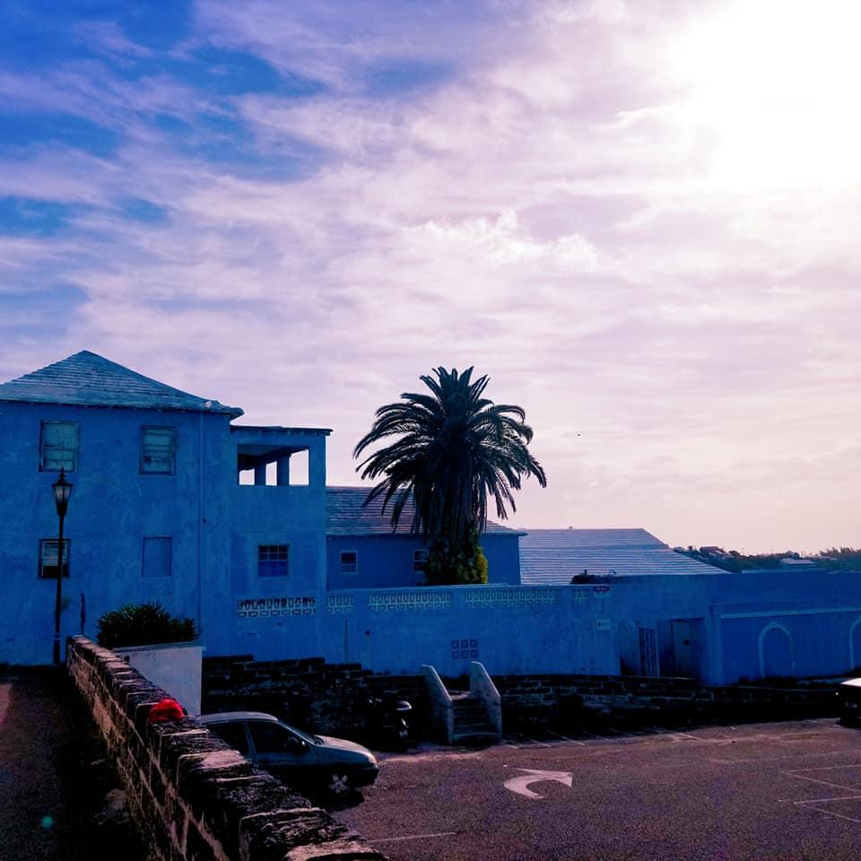 Buildings in St. George's, Bermuda during a beautiful purplish-blue sunset.