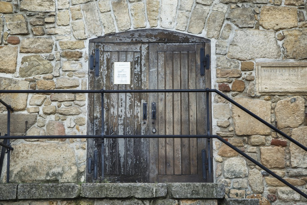 Old wooden door outside Tailors' Bastion in Cluj-Napoca, Romania