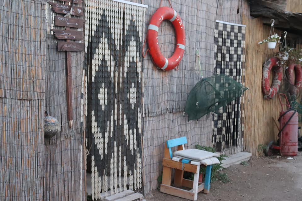 Beaded curtains and buoys hanging outside in Vama Veche.