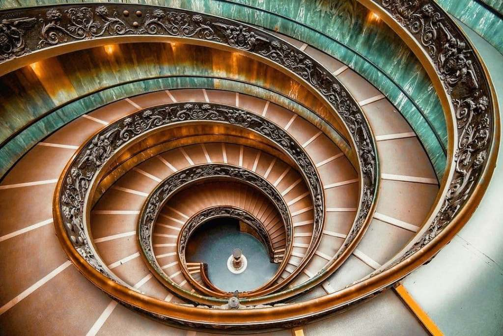 Bramante staircase at the Vatican Museum edited in hues of teal and orange.