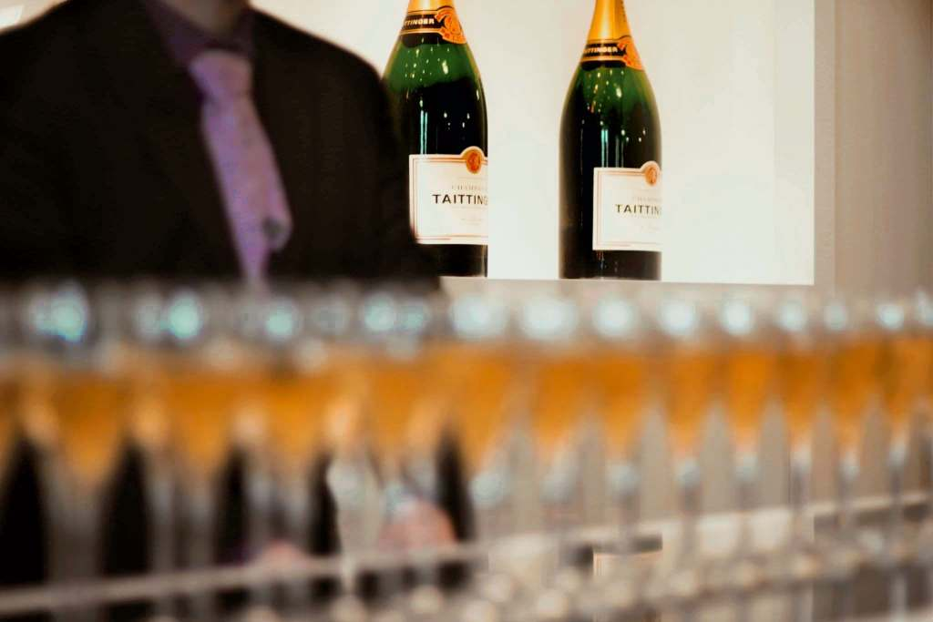 Blurred row of champagne glasses filled for a champagne tour in Reims at Taittinger.