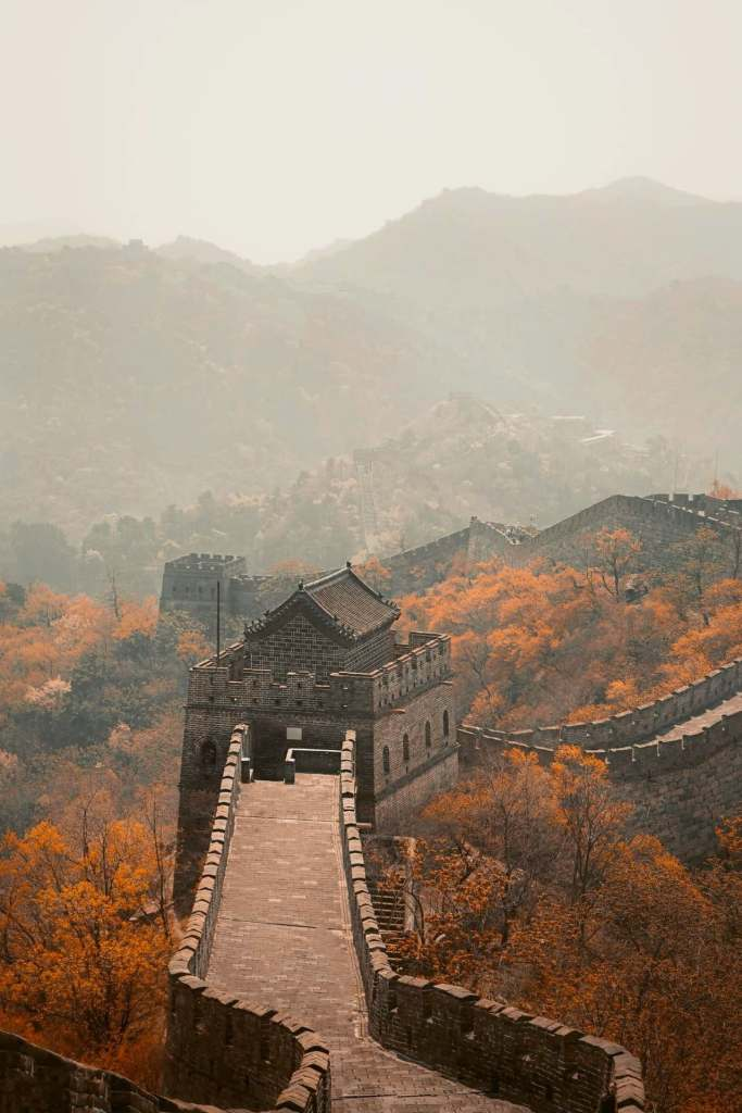 The Great Wall during golden hour with no tourists during orange sunset.