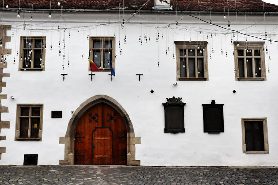 Exterior façade of Matthias Corvinus House in Cluj-Napoca, Romania