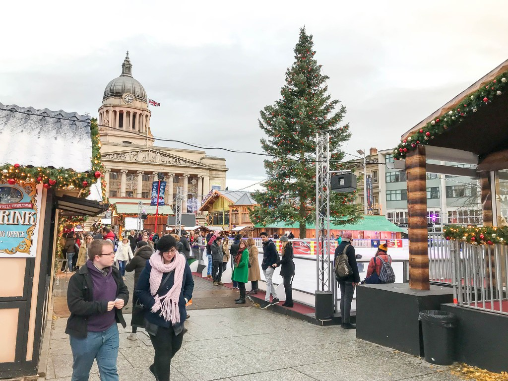 People strolling around dressed for winter in the magical Nottingham Christmas Market.