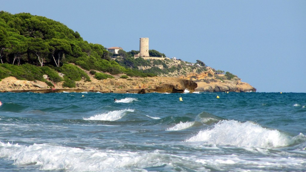 Waves crashing along the coast of Tarragona, Spain, an easy seaside day trip from Barcelona.