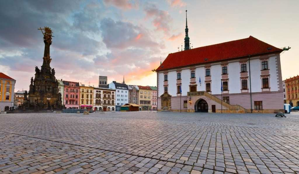 Main square in Olomouc, Czech Republic during sunset, a perfect day trip from Bratislava.