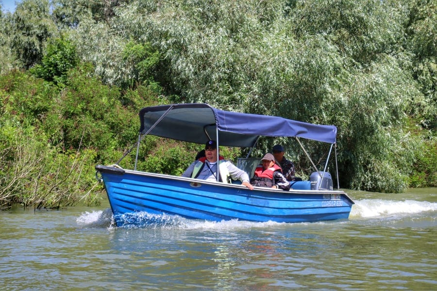 Blue covered boat on an excursion at the Danube Delta, Romania