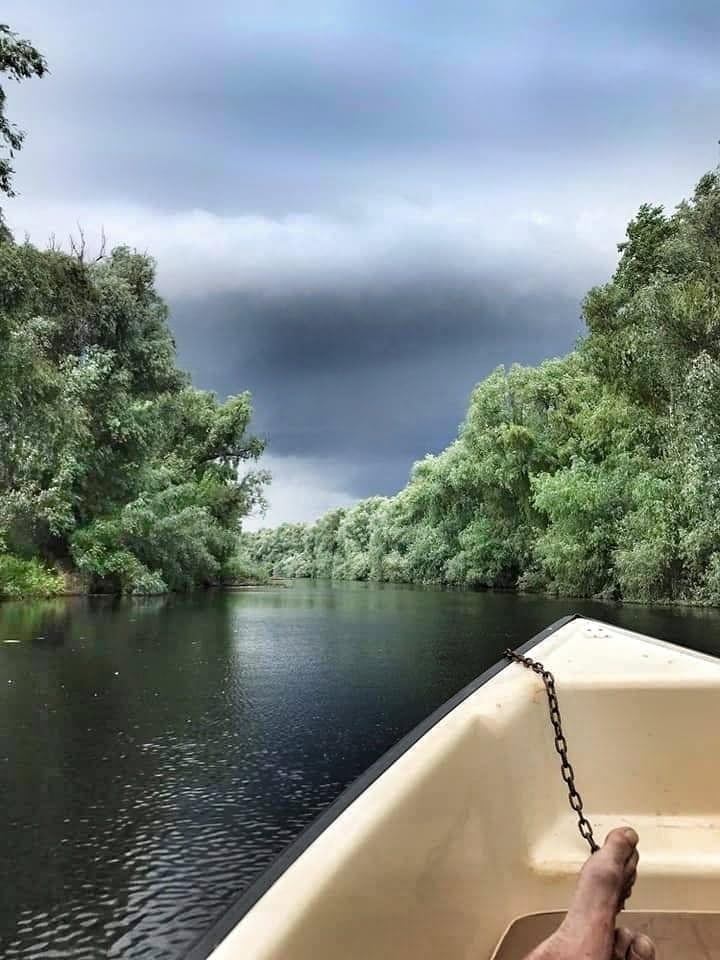Stormy skies over the Danube river in Danube Delta, Romania