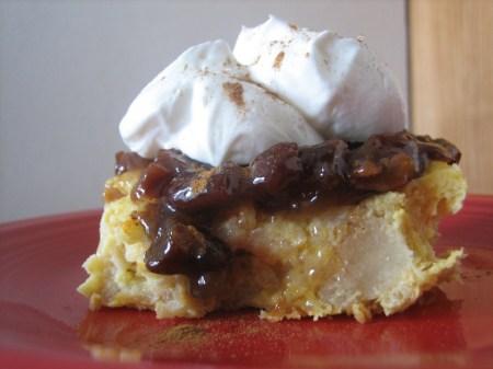 Orange bread pudding with gooey raisin sauce