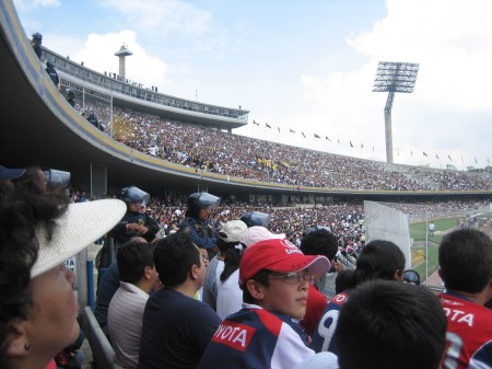 Riot police guard the Chivas fans at the Pumas soccer game on Sept. 27, 2009