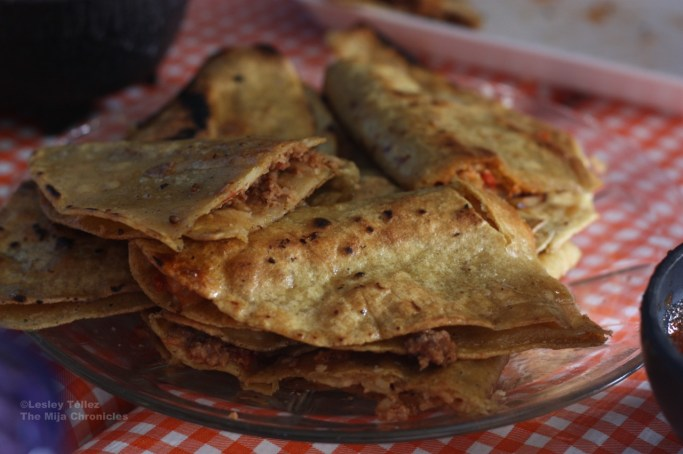 Quesadillas filled with various guisados -- tinga, mushrooms and picadillo -- at a small fonda in Nanacamilpa.