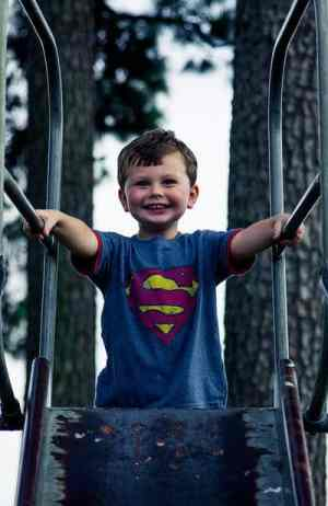 Boy on slide - Battle for the nap room