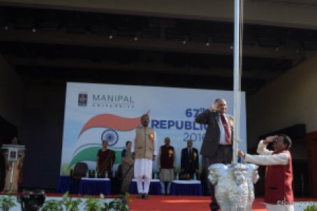 The Chief Guest Saluting the National Flag