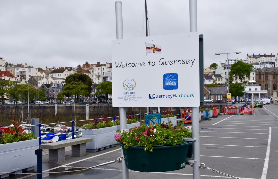 Welcome sign at the Guernsey harbor.