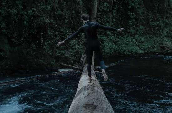 A man balancing on a log
