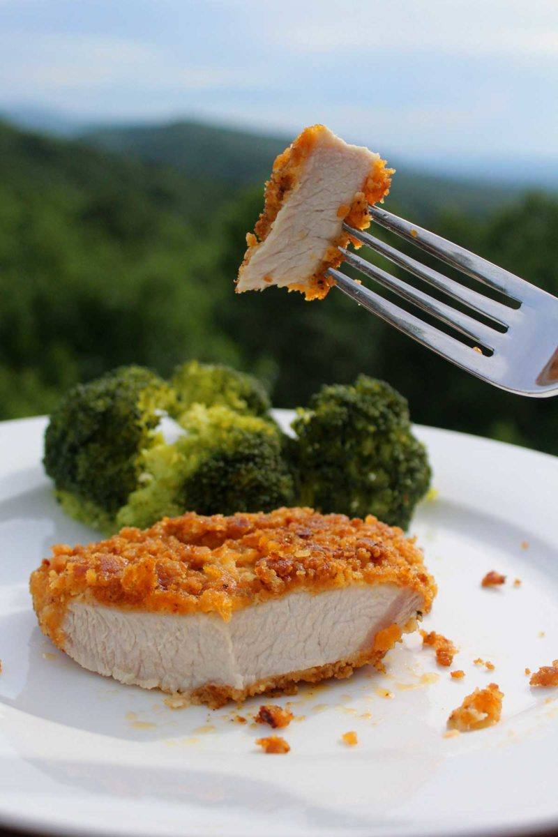 bite-size piece of pork chop on fork