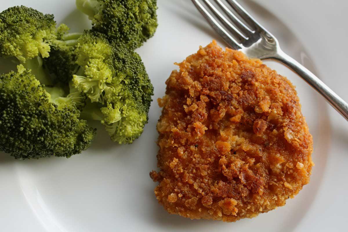 pork chop with broccoli on plate