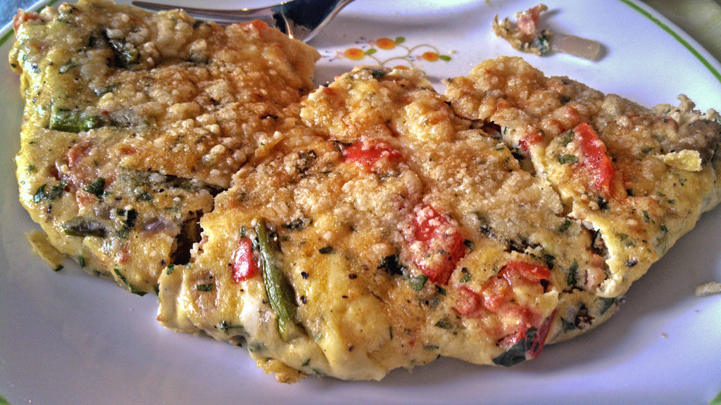 Have breakfast for supper with this vegetable herb frittata is made with fresh asparagus, red bell peppers, mushrooms and onions. A tasty meal any time! | TheMountainKitchen.com