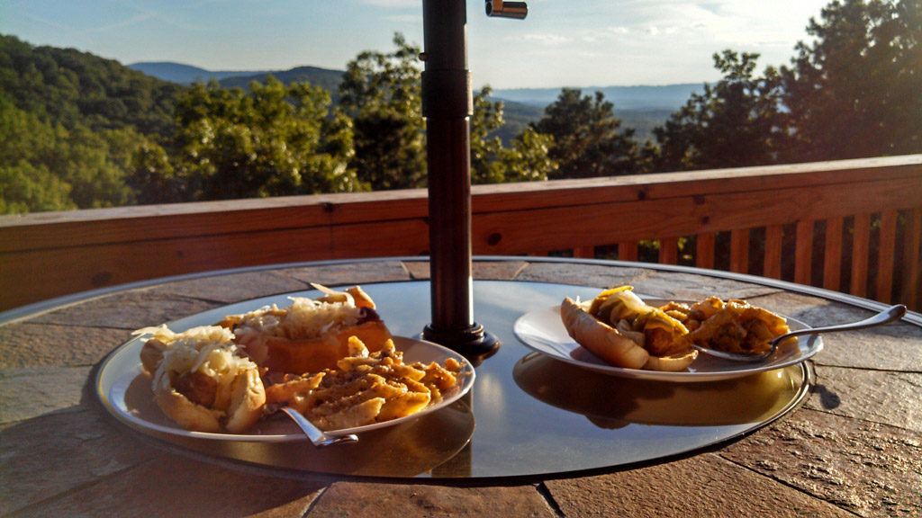 plates of grilled food with mountain view ideal deck sitting weather