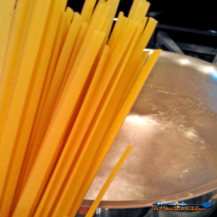 pasta in front of pot of boiling water