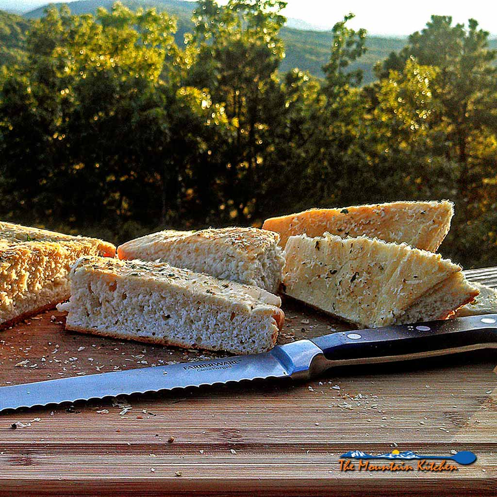 Homemade Focaccia Bread is a dimpled, slightly crisp, soft and chewy Italian flatbread seasoned with olive oil and Italian herbs. Italian yumminess!