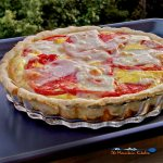 This spinach tomato tart is made of vine ripened tomatoes, fresh spinach, Swiss cheese and a savory creamy custard of eggs, flavored with dried mustard. | TheMountainKitchen.com