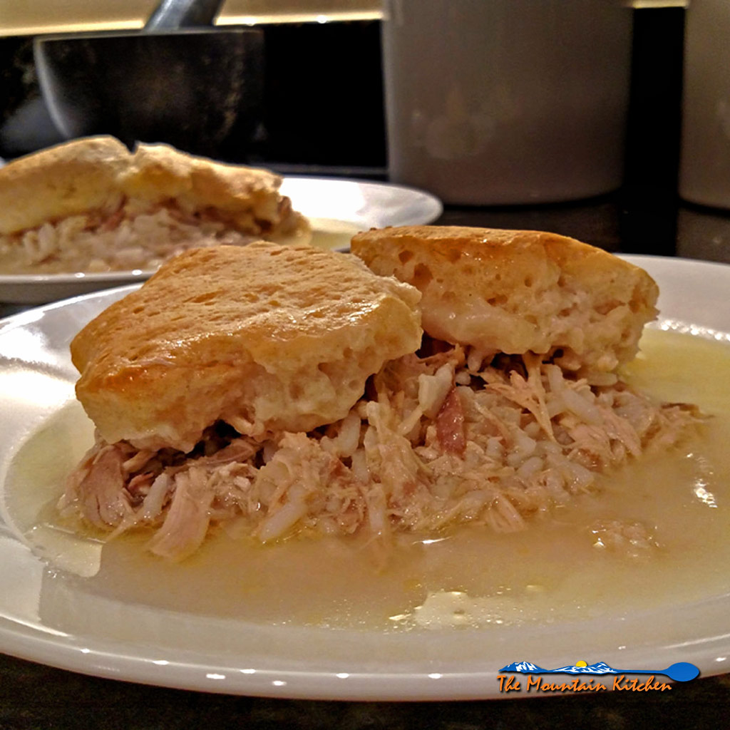 Chicken and Rice With Biscuits On Top, a rich creamy broth of chicken and rice with your favorite canned flaky biscuits baked on top. Simple, comfort food!