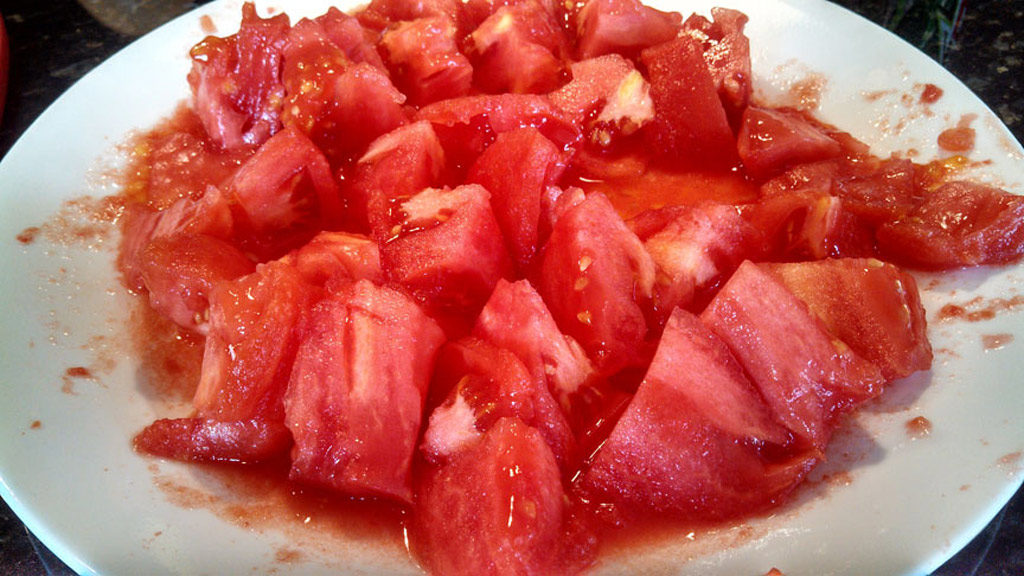 Easy to follow instructions on how to peel and core tomatoes. You can process 3-4 tomatoes at a time using the boiling water method. | TheMountainKitchen.com