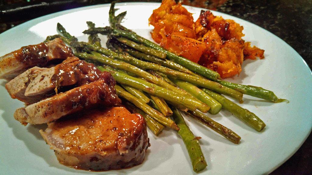 Mustard-Maple Pork Tenderloin: Oven roasted Dijon mustard pan seared tenderloin served with butternut squash and asparagus