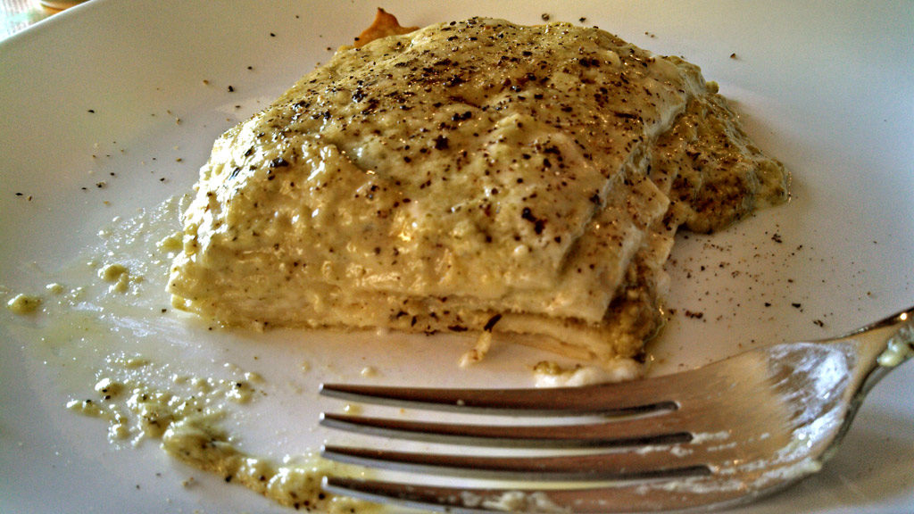 pesto lasagna on plate with fork
