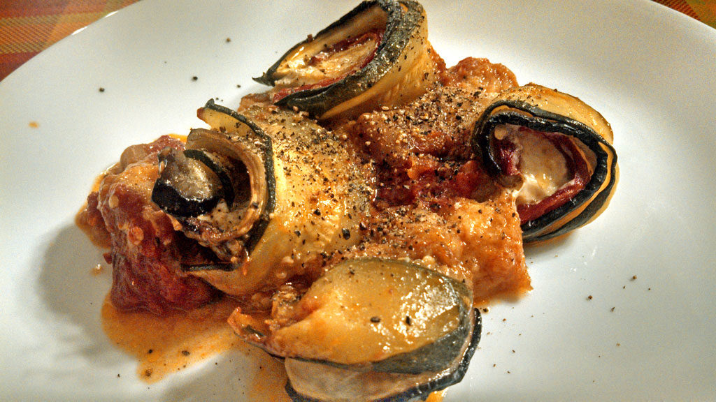 Ratatouille spirals are made of sliced eggplant, zucchini, roasted red peppers, creamy mozzarella cheese, and anchovies, rolled and baked in tomato sauce.   TheMountainKitchen.com