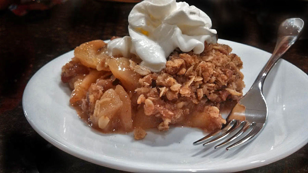 David's apple crisp uses fresh golden delicious apples and topped with rolled oats, sugar, cinnamon and pecans. A wonderful dessert for fall gatherings!   TheMountainKitchen.com