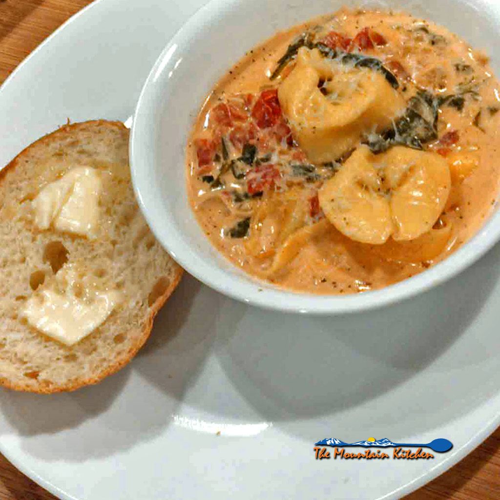 This quick and easy creamy tortelloni soup is filled with cheese tortelloni and fresh spinach. The ultimate comfort food for what ails ya!