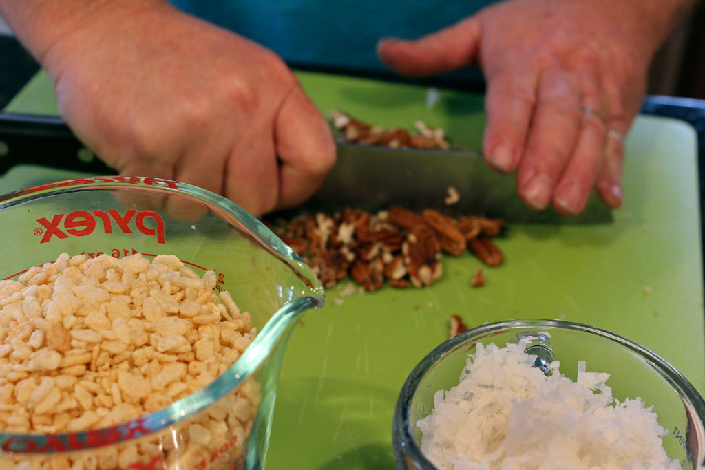 chopping pecans for date nut balls