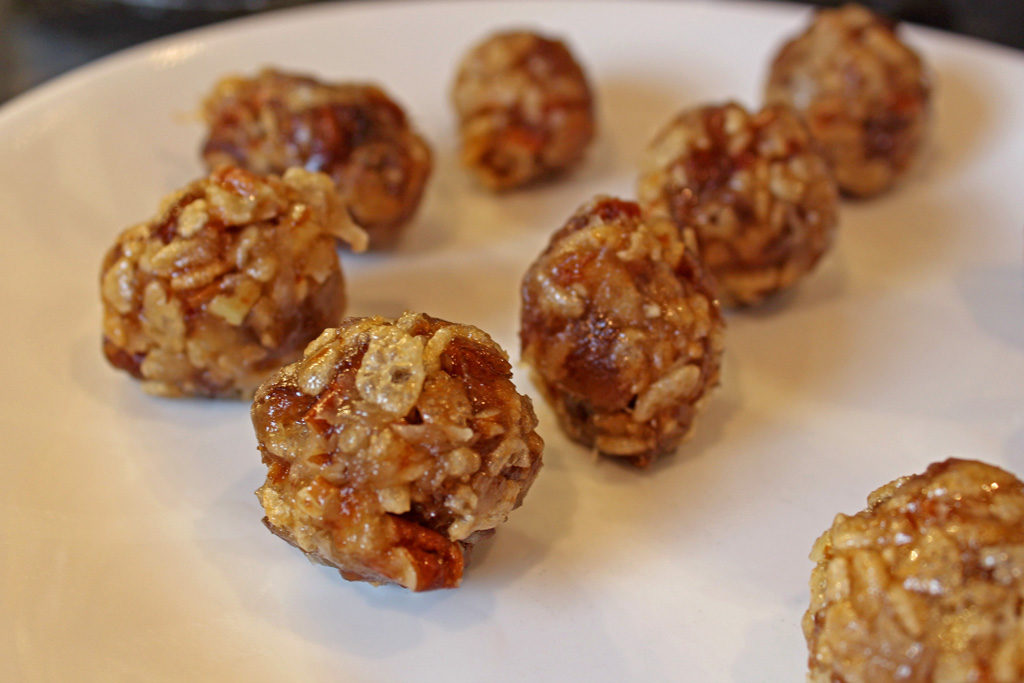 date nut balls on plate ready for powdered sugar