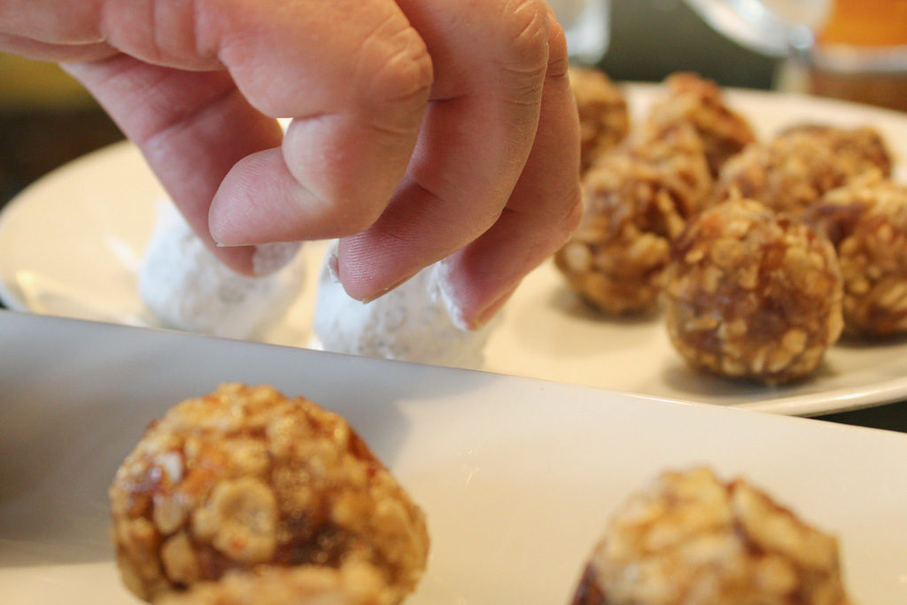 placing date nut balls on serving plate