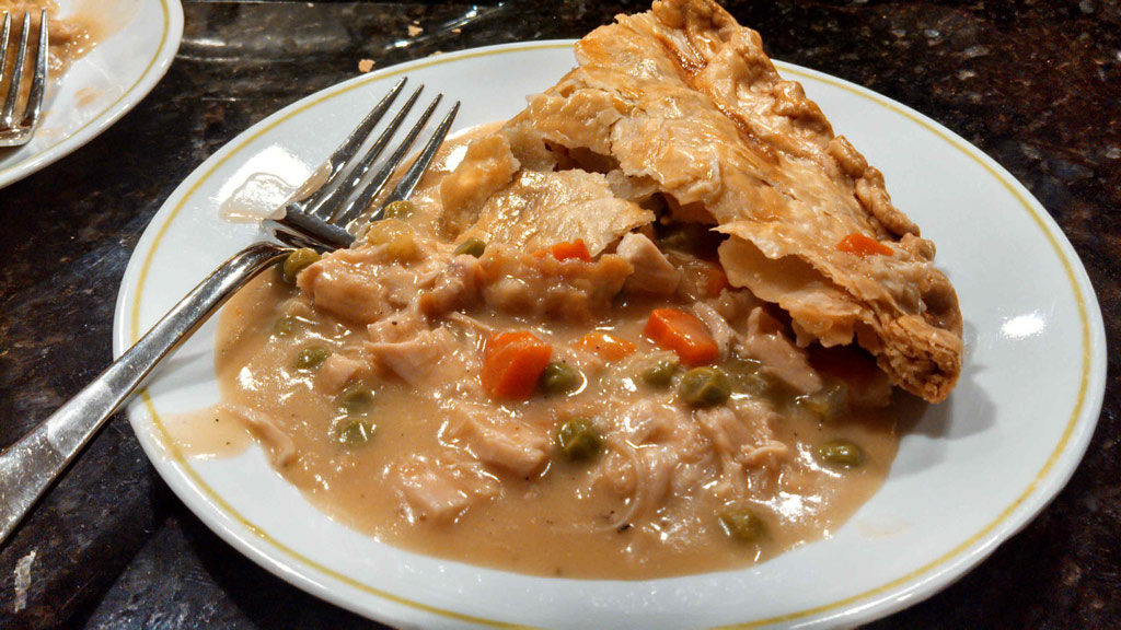 Classic chicken pot pie slopped on plate