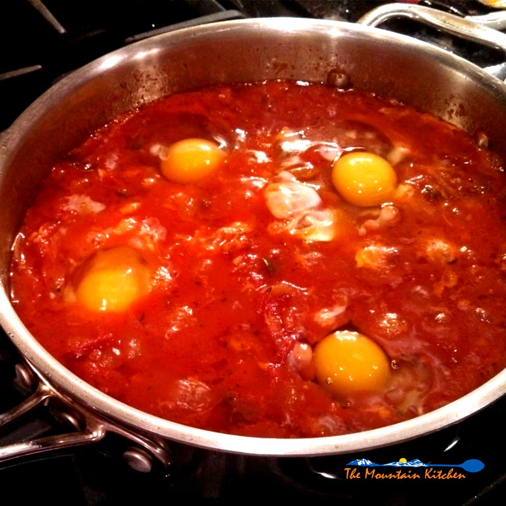 Eggs in Hell consists of eggs poached in a hot and spicy tomato sauce. A Middle Eastern dish with the perfect amount of spice and the warm richness of eggs.