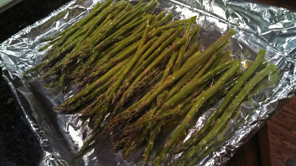 Oven roasted asparagus are coated in olive oil, lemon zest and parmesan cheese and roasted until tender, is one of my favorite asparagus recipes. YUMMY! | TheMountainKitchen.com