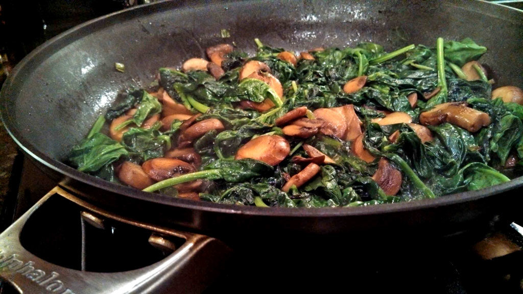 sauteed spinach in pan ready to serve