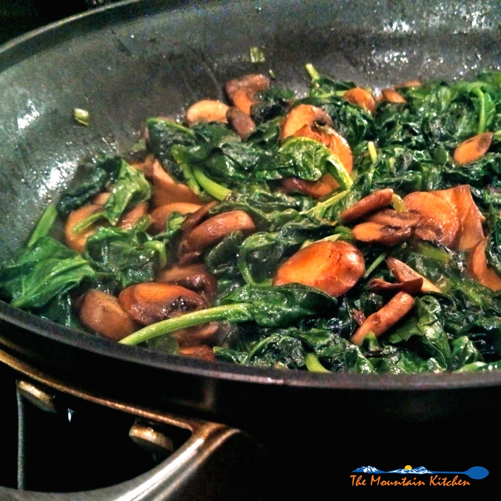 Tender sautéed spinach in butter and olive oil, with fresh mushrooms and green onions, is a quick easy and nutritious side dish, ready in just minutes!