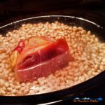 These slow-cooker navy beans are seasoned with smoky ham hock, slow cooked into a rich creamy pot of beans. A hearty meal on a cold winter day!   TheMountainKitchen.com